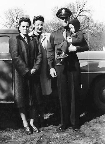 Darlene (Wilson) Scar, Doris (Wilson) Neal, Danny Wilson holding Richard Scar. April 1944, Minburn, Iowa