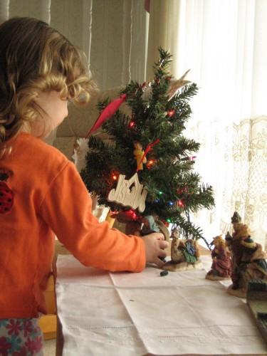 child and nativity scene