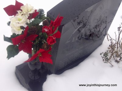 headstone in winter