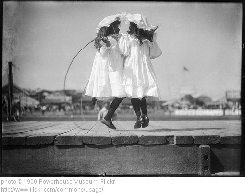 little girls jumping rope together