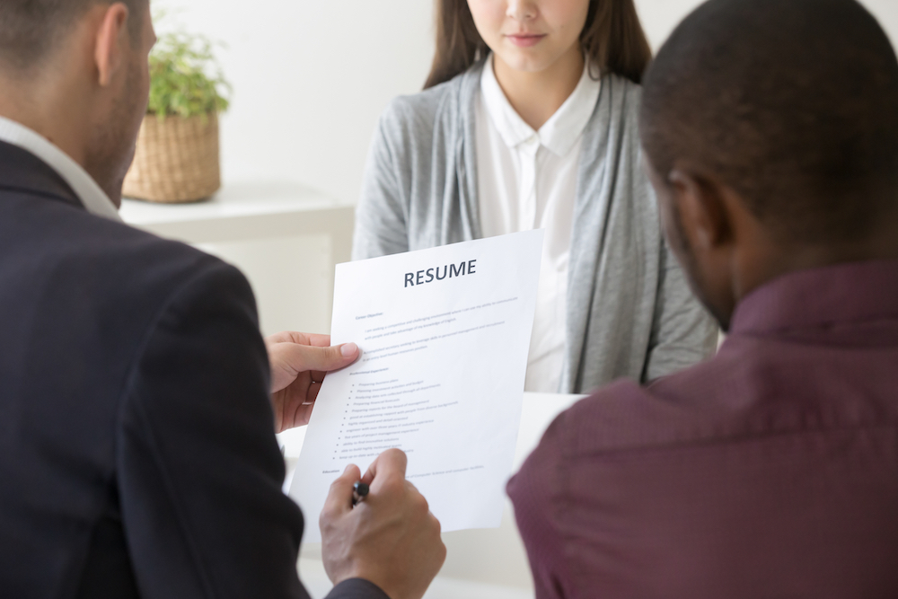 two managers looking at a resume for a candidate