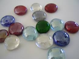 You can use glass stones for a tic tac toe game