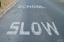 school sign on road