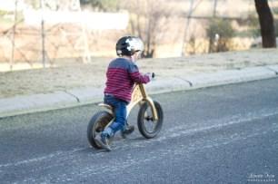 little boy riding his bike