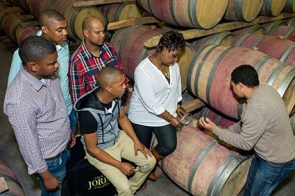 3.Anrico Solomons,Heinrich La Fleur,Elvezo Barry, Felicity Seholoba & Chriswin Willemse receiving a wine tasting from Denovan Daniels of Jordan Winery lr