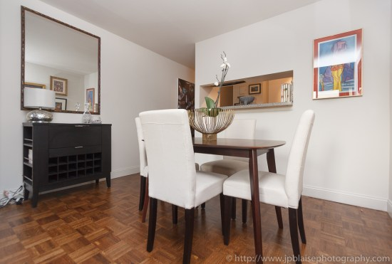 Real estate photographer work, dining room of a one bedroom duplex in midtown New York