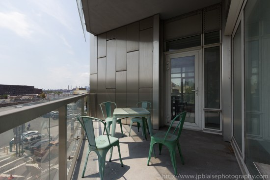 Balcony with table and chairs in two bedroom Long Island City apartment