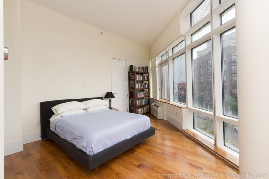 Bedroom photography with hardwood floors and large windows in Long Island City, Queens