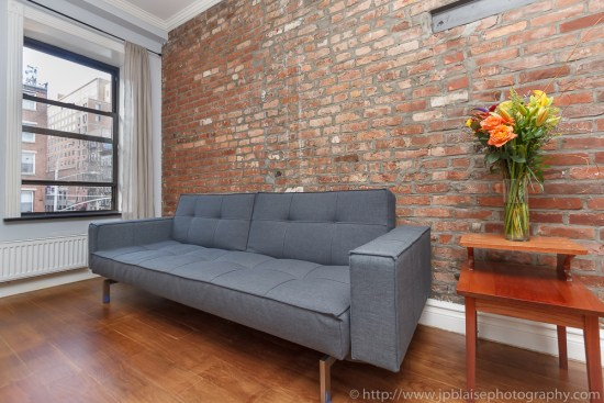 Blue sofa of an apartment in the east village of New York City