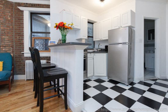 Real estate photography of open kitchen in Soho three bedroom apartment, NYC