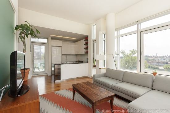 Professional photography of New York apartment : living room with open kitchen in Long Island City, Queens