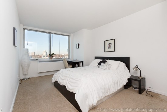 Interior photography: bedroom with bed in apartment overlooking the Hudson Rivers