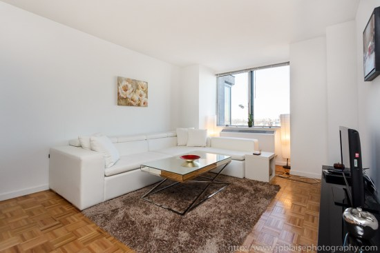 Apartment photography: white sofa of a one bedroom on the upper west side of manhattan new york city