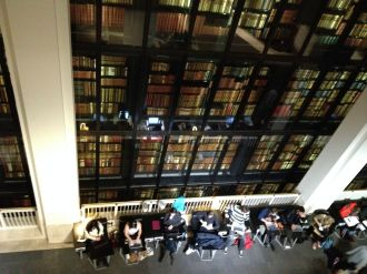 The center of this massive open structure is a 6 story wall of rare texts. I'm intrigued by this photo of all these students looking at their computers with their backs to the books.