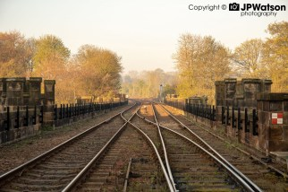 Early Morning Sunshine Over The Railway Tracks