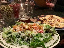A fresh salad and thin crust pizza