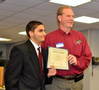David receives his certificate from his business mentor, Don