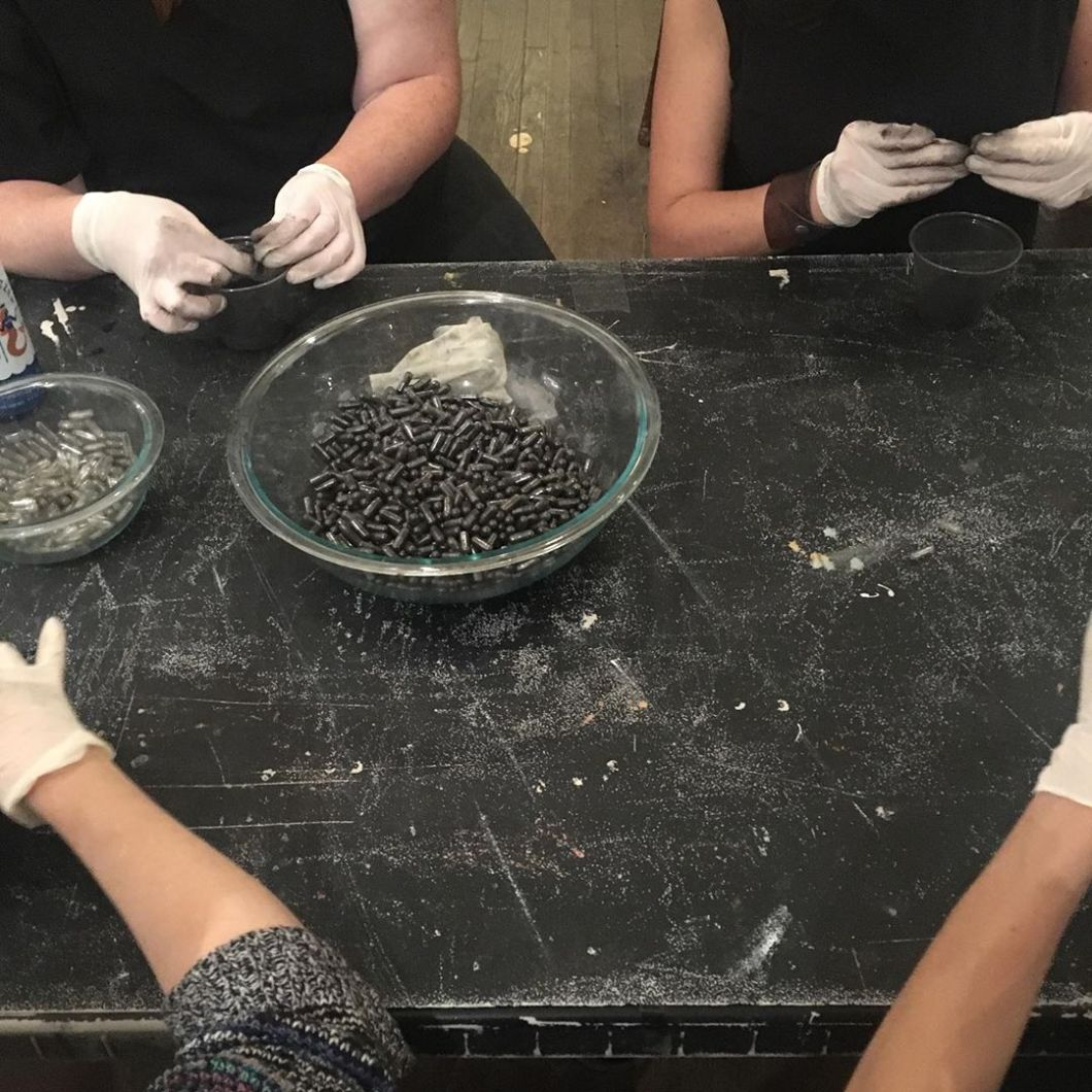 Last night an amazing group of folks came together to help me make pills from crushed Appalachian coal.  We made thousands of them, each representing a person who's died from opioid overdose in coal country.  These will form part of collaborative work with @queerappalachia as part @sound.scene – June 29-30 at @hirshhorn