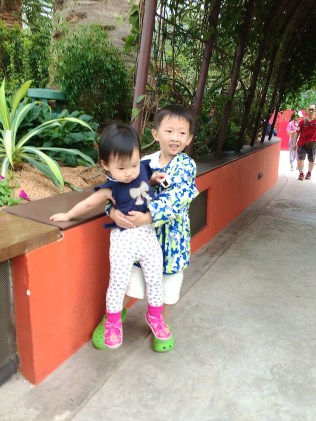 Isaac carrying Little E