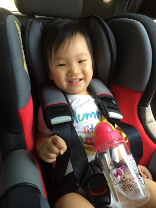 Happy in her car seat