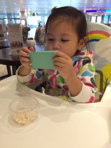 Abigail engrossed in video