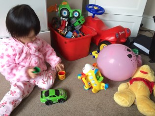 Engrossed with M's toys