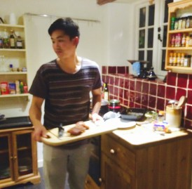 Shen presenting his roast pork
