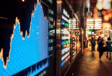 News24.com | Markets sink as rate hike fears trump recovery optimism