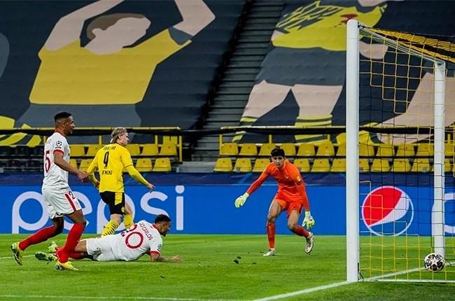 News24.com   Borussia Dortmund edge Sevilla to reach Champions League quarter-finals