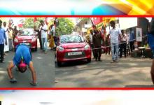 In Rs Puram, Yoga instructor pulls car walking upside down to support AIADMK candidate