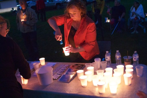 Marla Smart, a Winston resident, lights a candle at a vigil two days after Oregon's deadliest mass shooting in Roseburg, Oregon. Hundreds gathered in Winston, about eight miles south of Roseburg, for a vigil on Oct. 3, 2015.