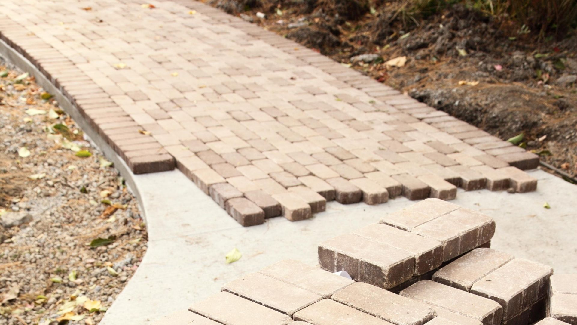 can pavers be installed over concrete