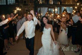 Bride & groom leaving through a sparkler exit