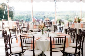 table setting at a tented wedding reception by j. scott catering