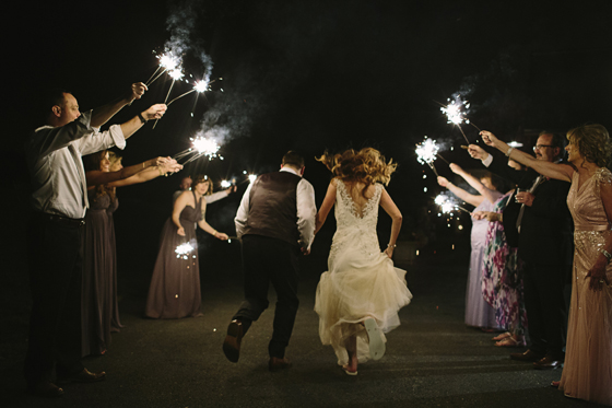 Bride and Groom run through sparklers