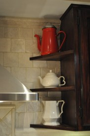 We added this corner display cabinet next to the stove, making good use of a small space.