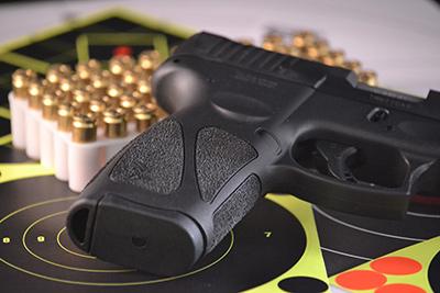 bullets and gun laying on firing range targets