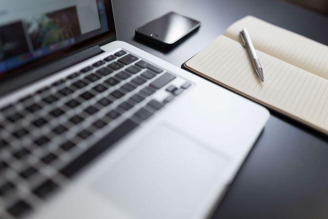 B2B technical martech writer writing photo of iPhone notebook pad an pen
