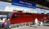 Passengers wait for the arrival of their train at the Meidling railway station in Vienna, on Monday, Nov. 30, 2009. (AP Photo/Hans Punz)