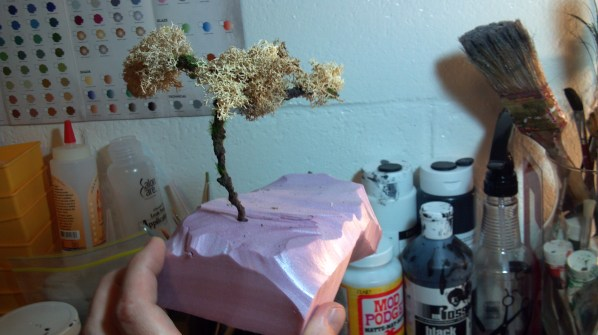 Making a miniature tree from foam, decorative vine and moss. Click to Enlarge.