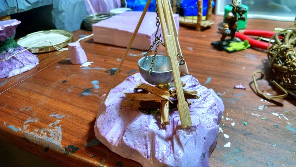 After sculpting the rock base into the foam, playing with wood placement for the fire. Click to Enlarge.