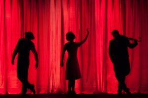 Shadows of actors on stage