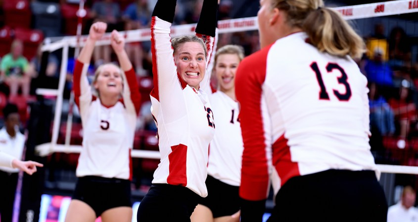 Number 23 Lexie Libs, setter of the week, celebrating with her teammates on the court. (Courtesy of JSU)