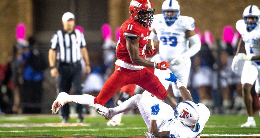 Wide Receiver Josh Pearson runs the ball down the field while running over a Tennessee State player. (Courtesy of JSU)