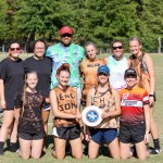 Ten members of the women's ultimate frisbee group at JSU pose for a photo holding a frisbee.