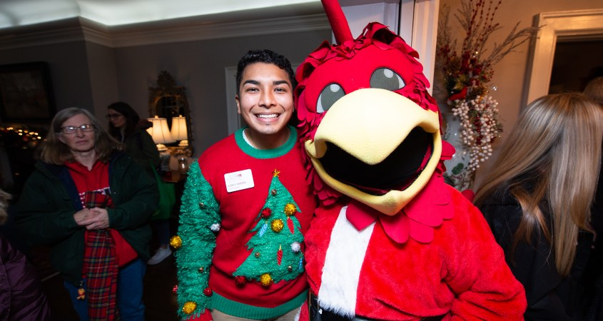 Pictured above, SGA President Ulises Herrera poses with beloved mascot Cocky at the annual JSU in Lights event on Dec. 2. Each December, JSU's president will open their home to students, faculty, staff and more, to celebrate the beginning of the holiday season. (Matt Reynolds/JSU)