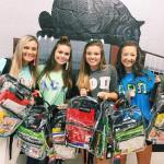 From left to right, Caylin Moore, Taylor Snider, Madison Shearer and Riley Sitton, all sisters of Alpha Omicron Pi, participate in their annual 'Gamecocks Give Back-Pack' event. (Ansley Winter/Alpha Omicron Pi)