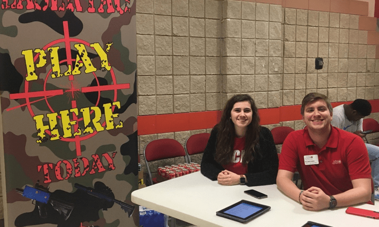 SGA vice president of public relations Kate Seibert, left, and SGA vice president of organizational affairs Will Bowen, right, assist students in the sign-in process for laser tag. (Zachary Grizzard/The Chanticleer)