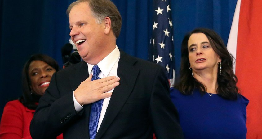 Doug Jones, pictured middle, is the incumbent Senator from Alabama. (John Bazemore/AP)