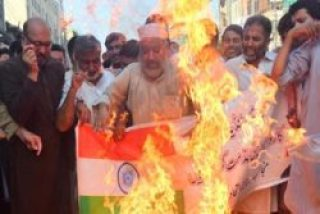 Protest against India the People of Pakistan are burning Indian National Flag.